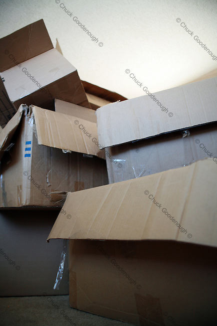 A Big Stack of Empty Moving Boxes piled in a New Home