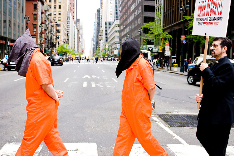 Demonstrators walk across the street during a protest in New York City on May 1, 2006 for those tortured and unjustly imprisoned at Guantanamo Bay.
