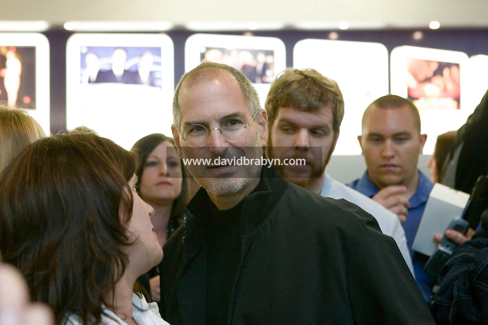 19 May 2006 - New York City, NY - Steve Jobs (3L, glasses), Apple's CEO, attends the opening of the new Apple Store on Fifth Avenue in New York City, USA, 19 May 2006.
