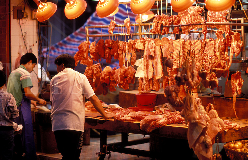 Hong Kong.  China.  Butcher's stall in open air market.