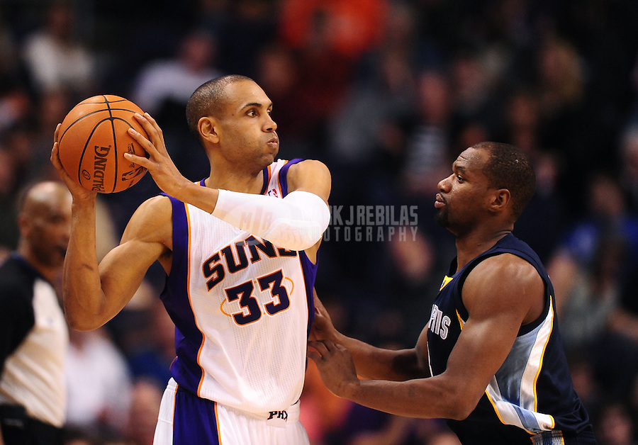 Jan. 28, 2012; Phoenix, AZ, USA; Phoenix Suns forward Grant Hill (33) guarded by Memphis Grizzlies forward Sam Young at the US Airways Center. The Suns defeated the Grizzlies 86-84. Mandatory Credit: Mark J. Rebilas-USA TODAY Sports