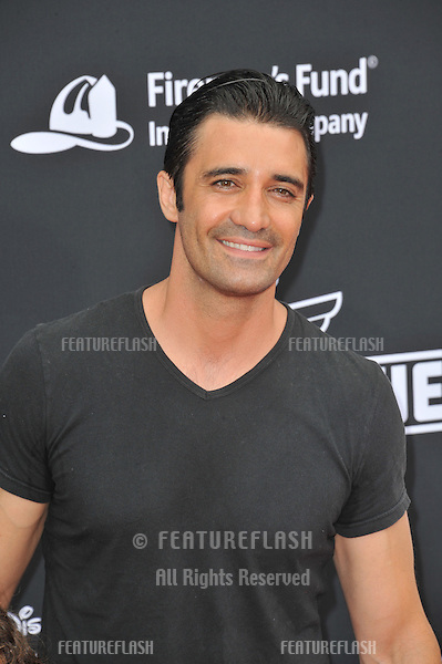 Gilles Marini at the world premiere of Disney's &quot;Planes: Fire &amp; Rescue&quot; at the El Capitan Theatre, Hollywood.<br /> July 15, 2014  Los Angeles, CA<br /> Picture: Paul Smith / Featureflash