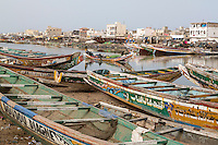 Senegal, Saint Louis.  Fishing Boat and Crew Head down the Senegal River toward the Atlantic.  Neighborhood of Guet N'Dar in background.