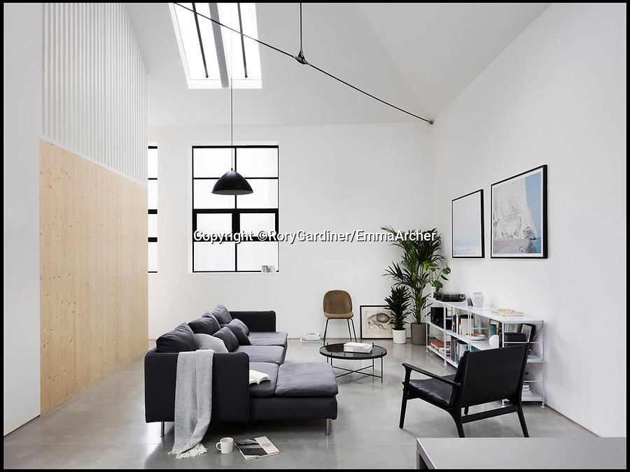 BNPS.co.uk (01202 558833)Pic: RoryGardiner/EmmaArcher/BNPS<br /> <br /> Stunning stripped back interior...<br /> <br /> Council Depot transformed into a million pound minimalist masterpiece.<br /> <br /> An architect has transformed a former council depot in Hackney into a stunning £1.35million property.<br /> <br /> James Davies, 34, has spent two years transforming the historic, dilapidated former school building in Stoke Newington, north east London, into a modern, stylish two-storey, two-bedroom house, living on site during the conversion. <br /> <br /> The renovation of the site at Defoe Road, which is yards from the high street, cost a hefty £350,000.<br /> <br /> But the investment has paid off handsomely as the property, which has its own inner courtyard, has already been snapped up for £1.35m.