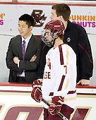 Samson Lee (BC - Video Coordinator), Kevin Pratt (BC - Manager), Isaac MacLeod (BC - 7) - The Boston College Eagles defeated the Merrimack College Warriors 4-2 to give Head Coach Jerry York his 900th collegiate win on Friday, February 17, 2012, at Kelley Rink at Conte Forum in Chestnut Hill, Massachusetts.