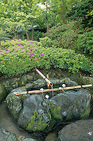 This Shinto shrine consists of a spring and a large boulder with a basin of water holding dippers to allow  pilgrims to wash or sip in honor of the  spirits, or kami, that live there.