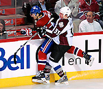 15 October 2009: Colorado Avalanche left wing forward Cody McLeod (55) checks Montreal Canadiens left wing forward Max Pacioretty at the Bell Centre in Montreal, Quebec, Canada. The Avalanche edged out the Habs 3-2 in Montreal's season home opener. Mandatory Credit: Ed Wolfstein Photo