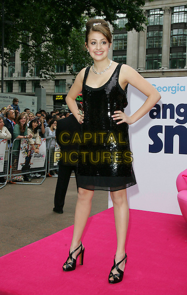 "GEORGIA GROOME .Attends the ""Angus, Thongs and Perfect Snogging"" UK Film Premiere at the Empire Cinema, London, England, .July 16, 2008..full length black sequined hair up necklace hair clip hands on hip dress butterfly ring shoes heels .CAP/ROS.©Steve Ross/Capital Pictures"