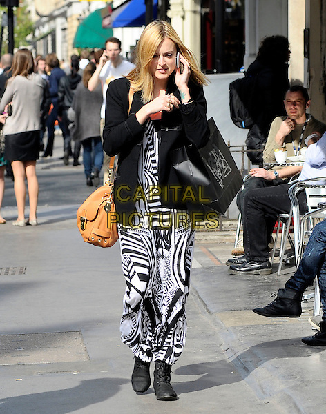 FEARNE COTTON.Leaving BBC Radio 1, London, England..March 24th, 2011.full length black white stripe print maxi dress jacket blazer brown bag purse 20th century fox talking on mobile phone.CAP/DYL.©Dylan/Capital Pictures.