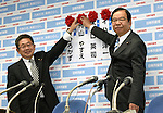 July 10, 2016, Tokyo, Japan - President Kazuo Shii, right, and Secretary-general Akira Koike of the Japanese Communist Party pose for photographers, pinning a red rose on the name of a Communist candidate at the party headquarters in Tokyo following Sundays upper house election. A field 389 candidates, including 42 from the Communist Party, across the country vied for half of the Diet upper chambers 242 seats in the triennial election.Prime Minister Shinzo Abes ruling coalition won a landslide victory despite doubts about his economic policies and his goal of revising the pacifist constitution.?(Photo by Natsuki Sakai/AFLO) AYF -mis-