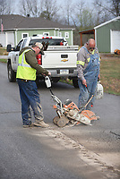 PAVING PREP<br />Darin Henson (left) and Stan Hendrickson, both with the Benton County Road Department, prepare Wednesday March 18 2020 a section of Tanglewood Road east of Rogers for paving. Crews are repaving the road, located in the Rocky Branch community near Beaver Lake. Go to nwaonline.com/200319Daily/ to see more photos.<br />(NWA Democrat-Gazette/Flip Putthoff)