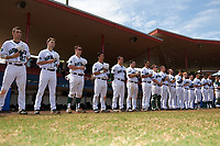 Dartmouth Big Green players stand for the national anthem before a game against the Lehigh Mountain Hawks on March 20, 2016 at Chain of Lakes Stadium in Winter Haven, Florida.  Dartmouth defeated Lehigh 5-4.  (Mike Janes/Four Seam Images)