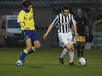 John McGinn being tackled by Cillian Sheridan in the St Mirren v Kilmarnock Clydesdale Bank Scottish Premier League match played at St Mirren Park, Paisley on 2.1.13.