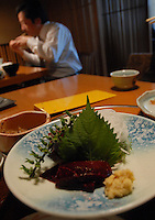 A customer eats whale steak at the Whale Sushimi (raw whale meat) at the Kujiraya (Whale) Restaurant in Shibuya, Tokyo Japan. The Restaurant is one of a few that serve exclusively whale meat in Tokyo..20 Nov 2007