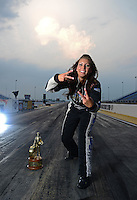 Jun. 28, 2012; Joliet, IL, USA: NHRA pro mod driver Leah Pruett poses for a portrait prior to the Route 66 Nationals at Route 66 Raceway. Mandatory Credit: Mark J. Rebilas-