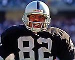 Oakland Raiders vs. Cincinnati Bengals at Oakland Alameda County Coliseum Sunday, October 25, 1998.  Raiders beat Bengals 27-10.  Oakland Raiders wide receiver James Jett (82).