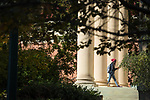 Walking through the columns at Fulton Chapel.  Photo by Kevin Bain/University Communications Photography