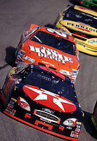 Ricky Rudd leads Tony Stewart and Steve Park at the Popsecret 400 at Rockingham, NC in October 2000. (Photo by Brian Cleary)