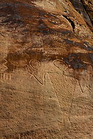 Petroglyps at Cub Creek created by the Fremont people who lived in the area between 550 and 1200 AD. They feature human and animal figures and abstract designs. Dinosaur National Monument, Utah USA.