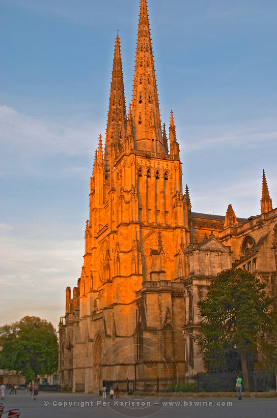 The Saint Andre Cathedral 11th 12th century with its majestic twin gothic towers in the evening at sunset on the place pey berland in Bordeaux, empty square city Bordeaux Gironde Aquitaine France
