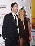 HOLLYWOOD, CA - NOVEMBER 05: Actors Melvil Poupaud (L) and Melanie Laurent arrive at the AFI FEST 2015 presented by Audi Opening Night Gala Premiere of Universal Pictures' 'By The Sea' at TCL Chinese 6 Theatres on November 5, 2015 in Hollywood, California.