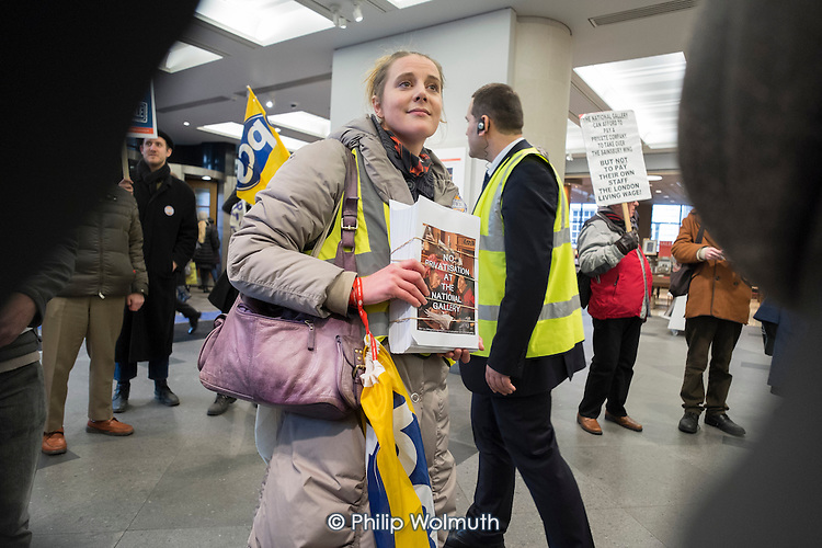 Protesters attempt to hand in a letter to National Gallery board member Mark Getty during a five-day strike by PCS members at the London gallery following a decision to privatise their jobs.