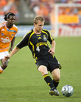 Columbus Crew defender Rusty Pierce (4) passes the ball. The Houston Dynamo tied the Columbus Crew 1-1 in a regular season MLS match at Robertson Stadium in Houston, TX on August 25, 2007.