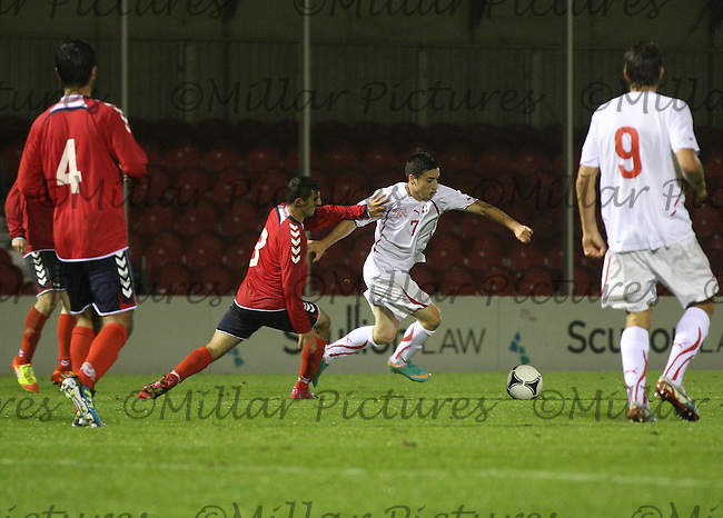 Endogan Adili holds off Sargis Shahinyan in the Armenia v Switzerland UEFA European Under-19 Championship Qualifying Round match at New Douglas Park, Hamilton on 11.10.12.