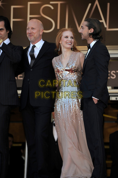 John Hillcoat , Jessica Chastain, Shia LaBeouf.'Lawless' screening at the 65th  Cannes Film Festival, France 19th May 2012.full length beige nude gold dress long maxi sequined sequin tuxedo black tux side hand in pocket arm around suit tie .CAP/PL.©Phil Loftus/Capital Pictures.