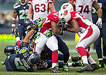 Arizona Cardinals running back Stephan Taylor (30) can't find any running room against Seattle Seahawks strong safety Kam Chancellor   (31) and linebacker,  K.J. Wright (50) and Bruce Irvin (51)at CenturyLink Field in Seattle, Washington on November 23, 2014. The Seahawks beat the Cardinals 19-3.   ©2014. Jim Bryant Photo. All Rights Reserved.