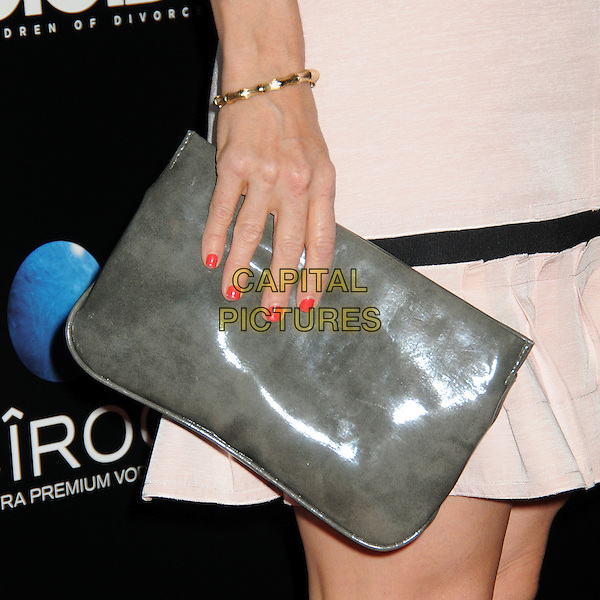 Arden Myrin's hand <br /> &quot;A.C.O.D.&quot; Los Angeles Premiere held at the Landmark Theatre, Los Angeles, California, USA, <br /> 26th September 2013.<br /> detail grey gray clutch bag hand gold bracelet <br /> CAP/ADM/BP<br /> &copy;Byron Purvis/AdMedia/Capital Pictures
