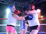 Dara Burke and Clara Carberry fighting in the White Collar Boxing in Ardee Parish Centre. Photo:Colin Bell/pressphotos.ie