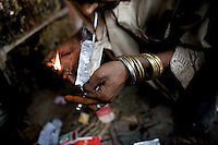A heroin addict smokes a dose of heroin on the second floor of a depot in front of a Mosque  in the city of Rawalpindi, Pakistan on Thursday November 27 2008.///...While Bangladesh, India, Nepal and Maldives all suffer from drug consumption, Pakistan is the worst victim of the drug trade in South Asia. Today, the country has the largest heroin consumer market in the south-west Asia region..The drug addicts resort to crime for generating income for the purchase of narcotics. The situation is becoming serious due to the number of heroin addicts in the country. An alarming rate of increase of 100,000 addicts per year is highly dangerous to society. The drug addicts are affecting nearly 20 million dependents and family members with psychological, social, and economic repercussions.