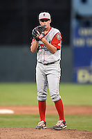 Lowell Spinners pitcher Brandon Show (38) gets ready to deliver a pitch during a game against the Batavia Muckdogs on July 18, 2014 at Dwyer Stadium in Batavia, New York.  Lowell defeated Batavia 11-2.  (Mike Janes/Four Seam Images)
