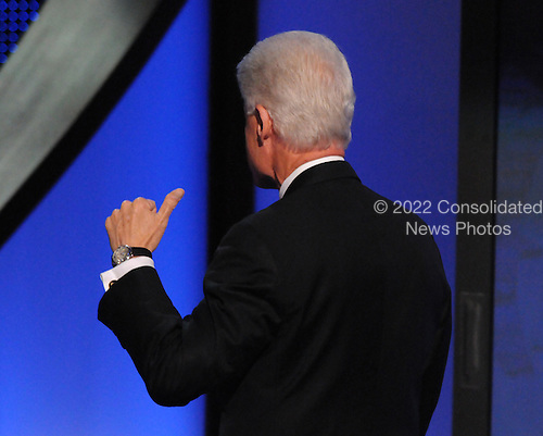 Denver, CO - August 27, 2008 -- Former United States President Bill Clinton gestures towards the crowd as he makes is way to senior party officials after making remarks endorsing United States Senator Barak Obama (Democrat of Illinois) during day 3 activities of the 2008 Democratic National Convention at the Pepsi Center in Denver, Colorado on Wednesday, August 27, 2008..Credit: Ron Sachs - CNP.(RESTRICTION: NO New York or New Jersey Newspapers or newspapers within a 75 mile radius of New York City)