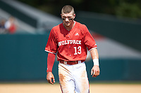 Brock Deatherage (13) of the North Carolina State Wolfpack walks off the field between innings of the game against the Army Black Knights at Doak Field at Dail Park on June 3, 2018 in Raleigh, North Carolina. The Wolfpack defeated the Black Knights 11-1. (Brian Westerholt/Four Seam Images)