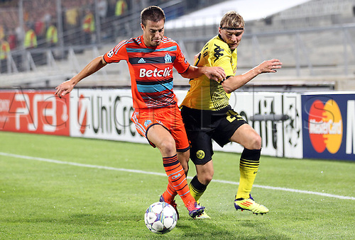 28.09.2011. Marseilles, France.  Dortmund's Marcel Schmelzer (r) and Marseille's Azpilicueta (l) fight for the ball during the Champions League group F soccer match between Olympique Marseille and Borussia Dortmund  in Marseille, France, 28 September 2011.
