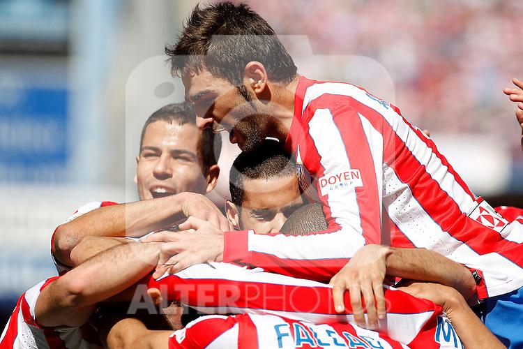 Atletico de Madrid's Adrian Lopez (r), Mario Suarez (c) and Alvaro Dominguez celebrate goal during La Liga match.March 11,2012. (ALTERPHOTOS/Acero)