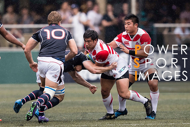 Ryoto Nakamura of Japan (R) in action during the Asia Rugby Championship 2017 match between Hong Kong and Japan on May 13, 2017 in Hong Kong, Hong Kong. (Photo by Cris Wong / Power Sport Images)