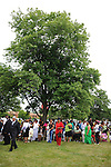 Families and relatives of those who buried their loved ones at the historically black Burr Oak Cemetery attend a prayer vigil across the street from Burr Oak in Alsip, Illinois on July 12, 2009.  On July 9, four managers and caretakers at the historically black Burr Oak Cemetery were arrested on charges of fraud and dismembering human remains; as families descended upon the site in search for answers, investigators were forced to close down the site as more dismembered human remains were discovered.