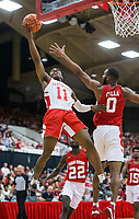 NWA Democrat-Gazette/BEN GOFF @NWABENGOFF<br /> JD Notae (11), Arkansas guard, shoots as Jeantal Cylla, Arkansas forward, defends in the second half Saturday, Oct. 5, 2019, during the annual Arkansas Red-White Game at Barnhill Arena in Fayetteville.