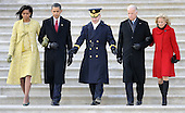 Washington, DC - January 20, 2009 -- United States President Barack Obama, his wife Michelle (L), Vice President Joseph Biden (2-R) and his wife Jill (R) are escorted by Major General Richard Rowe as they descend the steps of the U.S Capitol Building after Obama was sworn in as the 44th President of the United States during the 56th Presidential Inauguration ceremony in Washington, D.C., USA 20 January 2009..Credit: Tannen Maury - Pool via CNP