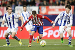 Atletico de Madrid's LucianoVietto (c) and Real Sociedad's Mikel Gonzalez (l) and Aritz Elustondo during La Liga match. March 1,2016. (ALTERPHOTOS/Acero)