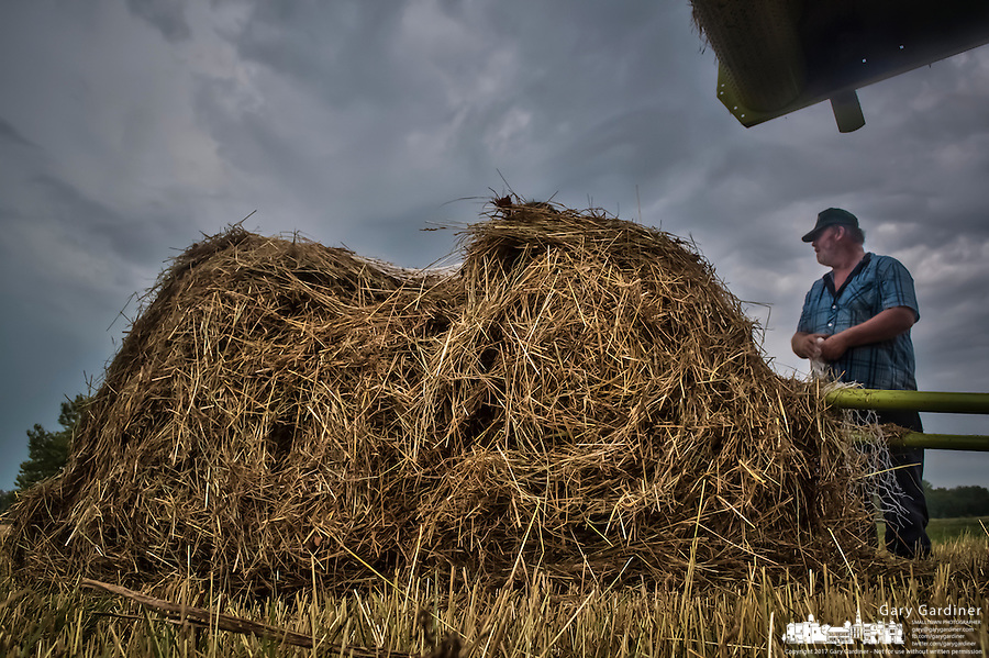 Late hay harvest on suburban farm.