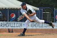 Asheville Tourists pitcher Mike Wolford #9 delivers a pitch during a game against the Augusta GreenJackets at McCormick Field Field on July 8, 2012 in Asheville, North Carolina. The Tourists defeated the GreenJackets 3-2. (Tony Farlow/Four Seam Images).