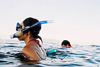 Julia Le, 35, left and her boyfriend Mark Hartman, 34, of San Jose, Calif., snorkel at Bai Nhat beach on Con Son Island, part of the Con Dao Islands.The 16 mountainous islands and islets are situated about 143 miles southeast of Ho Chi Minh City in Vietnam, in the South China. Photo taken Thursday, May 5, 2010...Kevin German / LUCEO For the New York Times