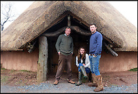 BNPS.co.uk (01202 558833)<br /> Pic: UpcottRoundhouse/BNPS<br /> <br /> ***Please Use Full Byline***<br /> <br /> Yabba-dabba-doo...<br /> <br /> Charles Cole, with his daughter Lizzie and son Hedley.<br /> <br /> A farmer has painstakingly recreated an Iron Age roundhouse to enable holidaymakers to release their inner Flintstone in the heart of the Devon countryside.<br /> <br /> Charles Cole has gone back over 2000 years to offer a back to basic's experience including a stone hearth fire, rudimentary plumbing, composting toilet and a six ton thatched roof to keep out the wind and rain.<br /> <br /> The amazing structure has been completely hand built by Charles and his family from materials sourced from their own farm and they have just opened up for bookings at &pound;170 a night.