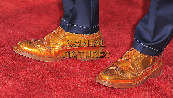 Kevin McHale's shoes .attends The 20th Century Fox 'Glee 3D' Concert World Movie Premiere held at The Regency Village theatre in Westwood, California, USA, .August 6th 2011..detail feet orange gold brogues  metallic shiny .CAP/RKE/DVS.©DVS/RockinExposures/Capital Pictures.