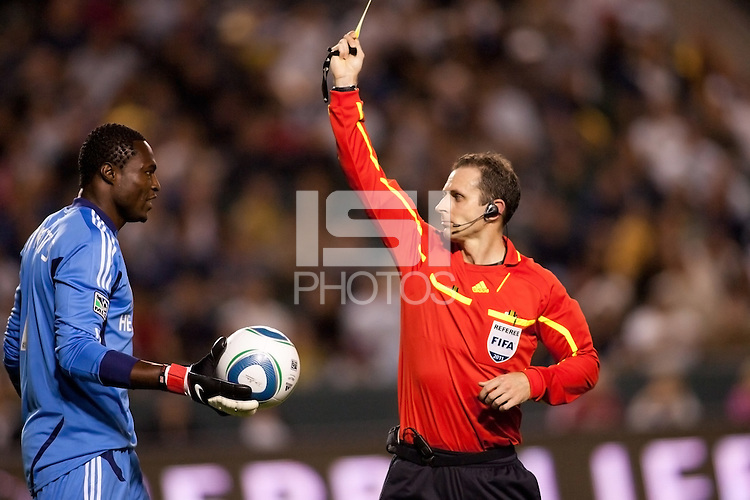 Referee Paul Ward shows LA Galaxy goal keep Donovan Ricketts (1) red. The LA Galaxy defeated the Philadelphia Union 1-0 at Home Depot Center stadium in Carson, California on  April  2, 2011....