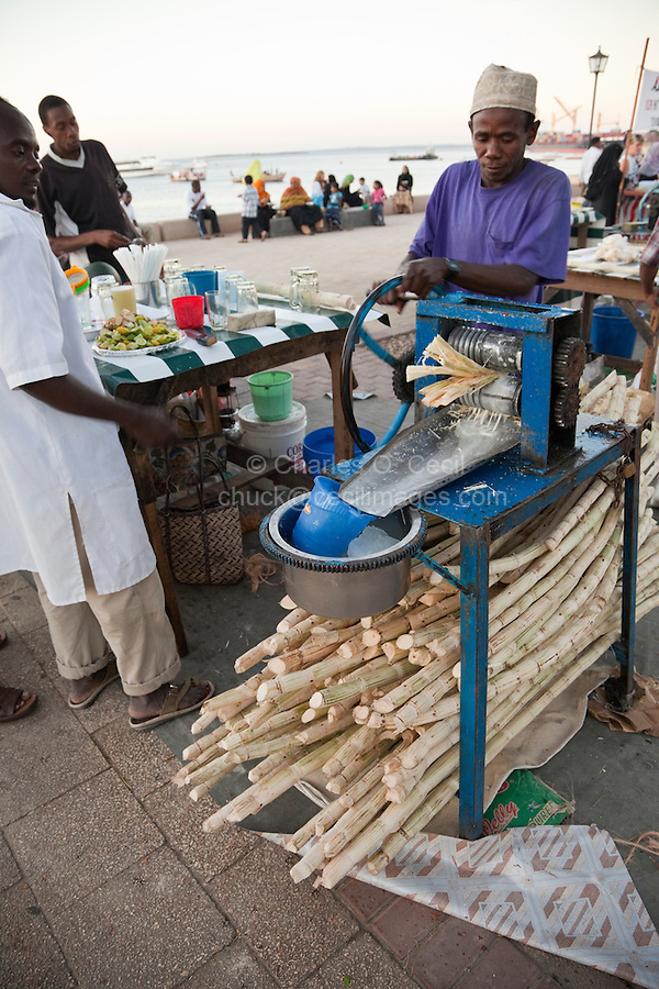 Forodhani Gardens, Stone Town, Zanzibar.  Squeezing Sugar Cane to Make Juice.